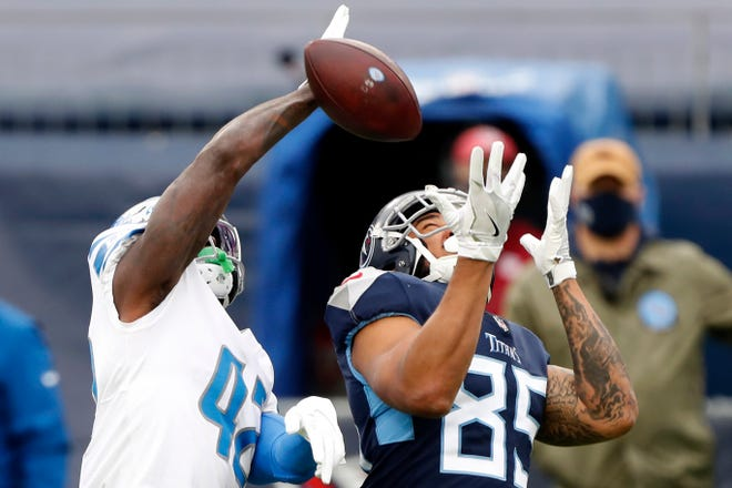 Tight ending MyCole Pruitt (85) of Tennessee Titans failed to complete Jayron Kearse (42) security pass from Detroit Lions during the first quarter of the match at Nissan Stadium on December 20, 2020 in Nashville, Tennessee.