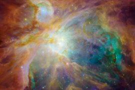 NASA shared some interstellar fireworks to end 2020. The Orion Nebula resembles a rainbow-colored painting filled with dots of light.