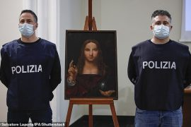 """Agents of the crime against heritage division of the Naples Flying Squad display """"Salvatore Mundi"""", A painting from the Leonardo School dating back to the 15th century"""