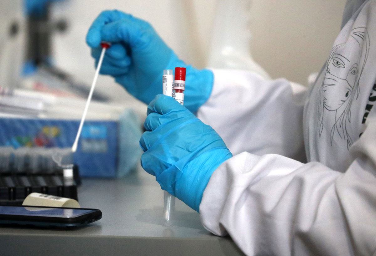 A medical worker handles samples at an express Covid-19 testing lab at Vnukovo International Airport on January 12.