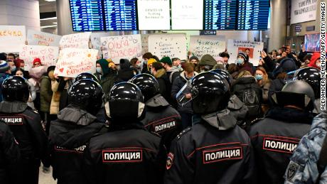 Riot police stand guard at Vnukovo airport in Moscow ahead of Alexei Navalny's arrival on Sunday.