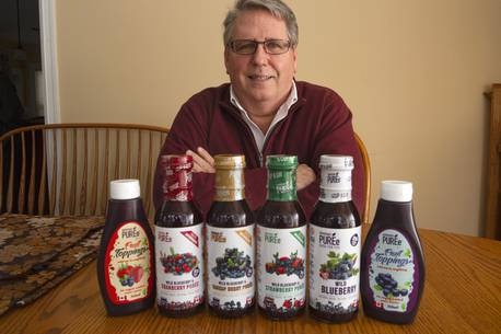 Tom Margeson, president and CEO of Healthy Berries Ltd., with some of his Superfruit Puree products at his Beaver Bank home on Monday, Feb. 1, 2021.